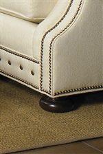 Bun shaped feet and decorative nail head trim are features on items in this collection