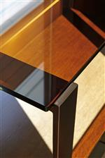 Amber-Tinted Glass Shelves and Table Tops on Select Pieces