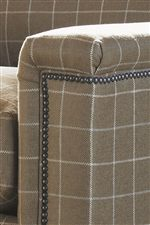 Upholstered Track Arms with a 3/8-Inch Nickel Nailhead Trim Create Intrigue and Visual Interest
