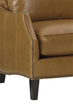 Scalloped Arms with Nailhead Trim Add Interest to This Relaxed Style