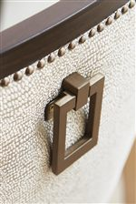 Upholstered Host Chairs Adorned with Pendant Pull Hardware