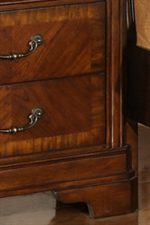 Classic Bracket Feet and Warm Patterned Veneers Add Traditional Appeal