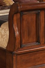Detail of Raised Panel and Curved Top and Side of Footboard in Panel Bed