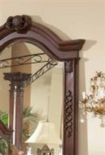 Arched Mirror Frame with Carved Detailing.