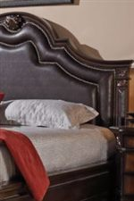 Headboard Centerpiece is Upholstered in Dark Brown Faux Leather with Nailhead Detailing