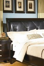 Dark Brown Leather Headboard With Tufted Detailing.