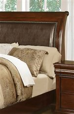 Faux Leather Inserts and Nailhead Trim on Elegant Sleigh Headboard