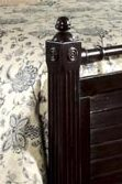 Round Finials, Wood Rosettes, and Reed Molding Give Character to Select Items
