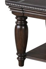 Polished and Refined Turned Legs, Nailhead Studs, and a Bonded Leather Inlay Complete this Exceptional Look