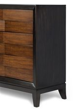 Sleek Black Smoke Frame Contrasts With Cognac Drawer Fronts