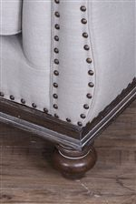 Exposed Wood Trim and a Border of Nailhead Studs Add Eye-Catching Detail