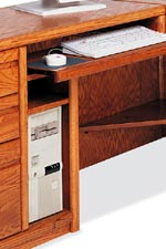 Most desks feature pull-out keyboard drawers and CPU storage. Some also feature built-in shelving in the kneeholes.
