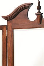 Center Finnial and Arched Top with Decorative Cutouts and Molding Details