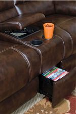 Storage Console in the Arm of the Love Seat with Cup Holders