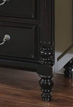 Fluted and Turned Accents Along with Framed Drawer Faces