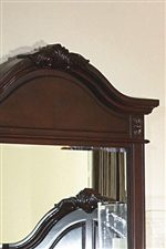 The Mirror's Crown Echoes the Decorative Headboard