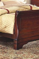 Sleigh Footboard with Paneling and Carved Moldings.
