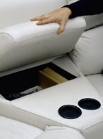 Console features cup holders and extra storage.