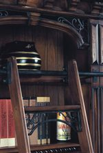 A Sliding Library Ladder Creates a Luxurious Old-World Feeling