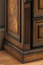 Thick Base Moldings, Interesting Veneers, Carved Columns are Featured in the Collection