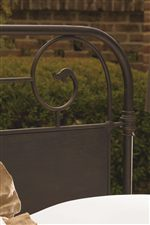 Scroll Headboard with an Oiled Bronze Finish and Foliage Accent Motif Gives the Garden Gate Bed a Romantic, Timeless Feel