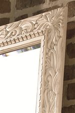 Intricate Dentil Moulding and Foliage Carvings Give the Decorative Mirror Character and Elegance