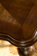 Select Tables Feature Step-Down Moldings and Gracefully Curved Corners