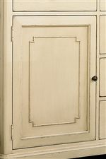 Collection Features Doors and Sides with Frame Molding, Often Accented by Raised Line Molding