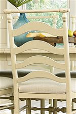 A Shapely Ladder Back on the River House Chairs Evokes Gentle Waves