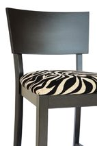 Zebra Skin Upholstery Complimented by Black Finished Woodwork