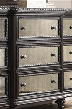 Intricate Silver Egg and Dart Moldings Framing Antique Mirror Panels