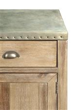 Metal-Wrapped Tops with Nailhead Studs and a Galvanized Finish Create an Eclectic Industrial Look