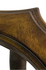 A Curved Beveled Edge that Comes to a Point is Featured on the Occasional Table in this Collection.