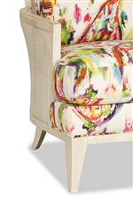 Exposed Wood  and Woven Accents Add Cozy Character to The Modern Shape of This Chair