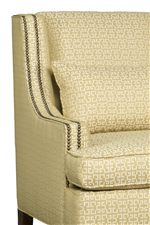 Slender, Sloped Track Arms with Striking Nailhead Trim