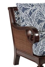 Scrolled Wood Arms and Wicker-Like Insert Create a  Luxurious Take on Tropical Style