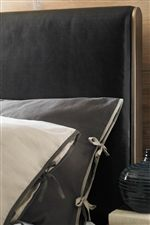 Worn Metal Intertwines with Dark Upholstery in this Collection's Bedroom Set