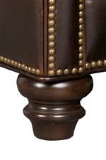 Turned Wood Feet Highlighted by Nailhead Trim