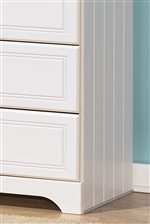 Elegant Grooved Panels and Embossed Bead Framing Drawers