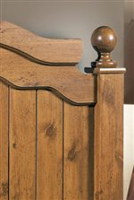 Plank Details and an Arched Top Moulding Give this Headboard a