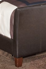 Sleek Faux Leather Foot Board Above Square Tapered Wood Feet
