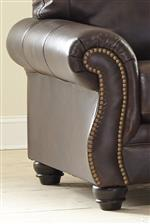 Shaped Rolled Arms with Nailhead Trim. Turned Feet in Dark Finish.