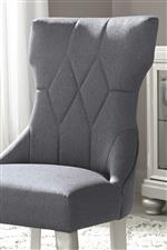Gray Textured Fabric and Shaped Back on Chair