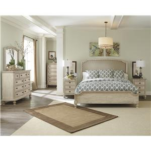 Signature Design by Ashley Demarlos Queen Upholstered Panel Bed