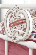 French-Inspired Scrolling Detail on Metal Bed