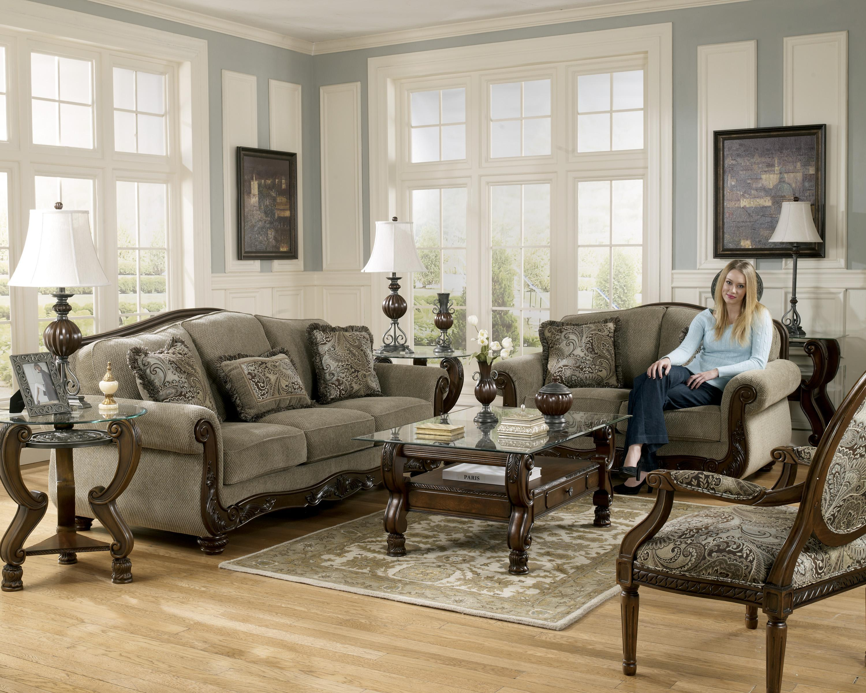 Signature Design By Ashley Fresco Traditional Camel Back Sofa With Exposed  Wood Trim | Rotmans | Sofas Worcester, Boston, MA, Providence, RI, ...