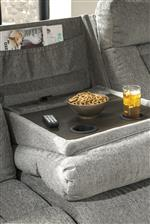 Drop down table, storage pouch, and cup holders