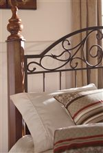 Classic Beds Posts and Scrolled Metal at Center of Headboard