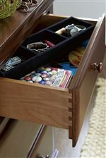 Dovetail Joinery Ensures Sturdy Drawers, While Features like Jewelry Trays Encourage Organization