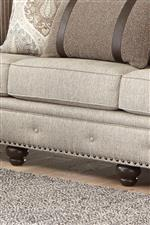 Button Tufting and Nailhead Trim Along Base Supported by Turned Feet